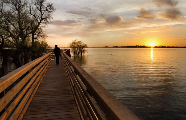 photograph of walkway to gazebo at Barr Lake State Park during sunrise