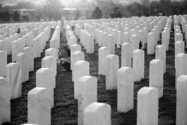 Morning light falls on to the grave stones at Fort Logan National Cemetery before sunrise, May 25, 2013.