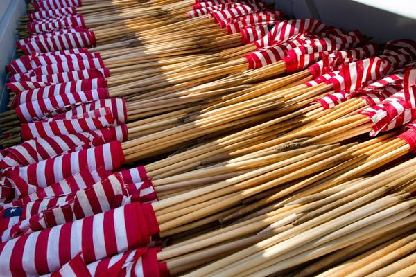 Flags waiting to be planted by the volunteers at Fort Logan National Cemetery.